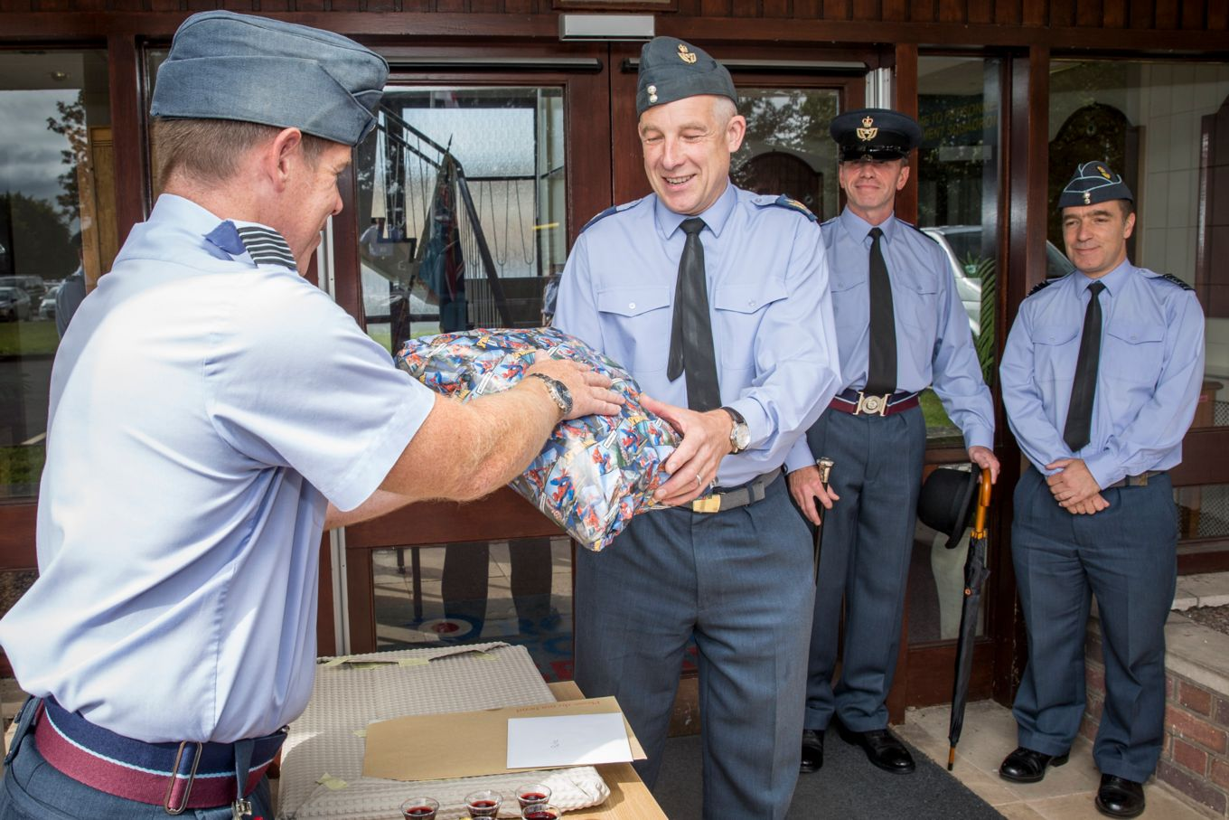 WO OLoughlin outside SHQ receiving gifts