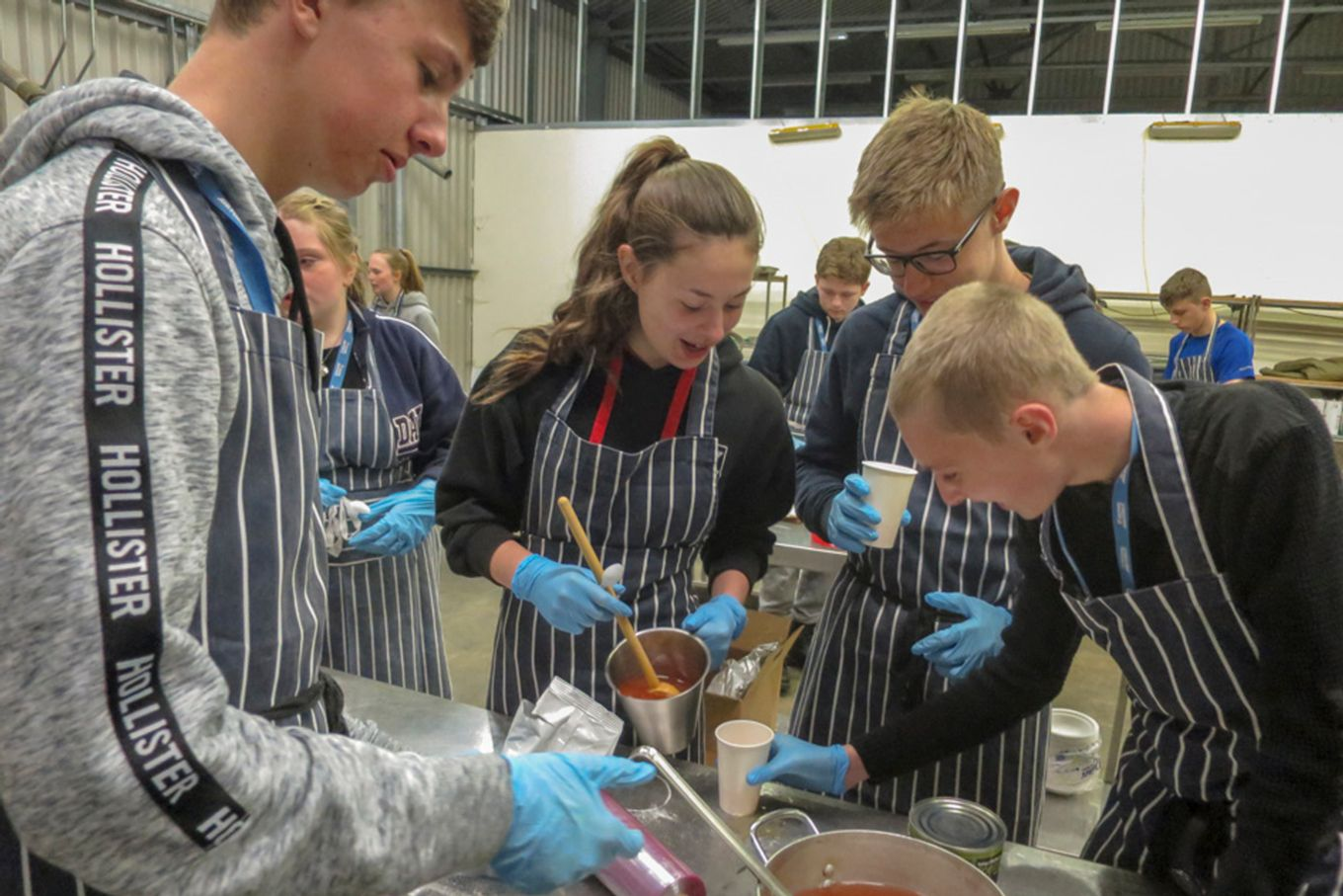 The students learn military catering with 3 Mobile Catering Squadron.