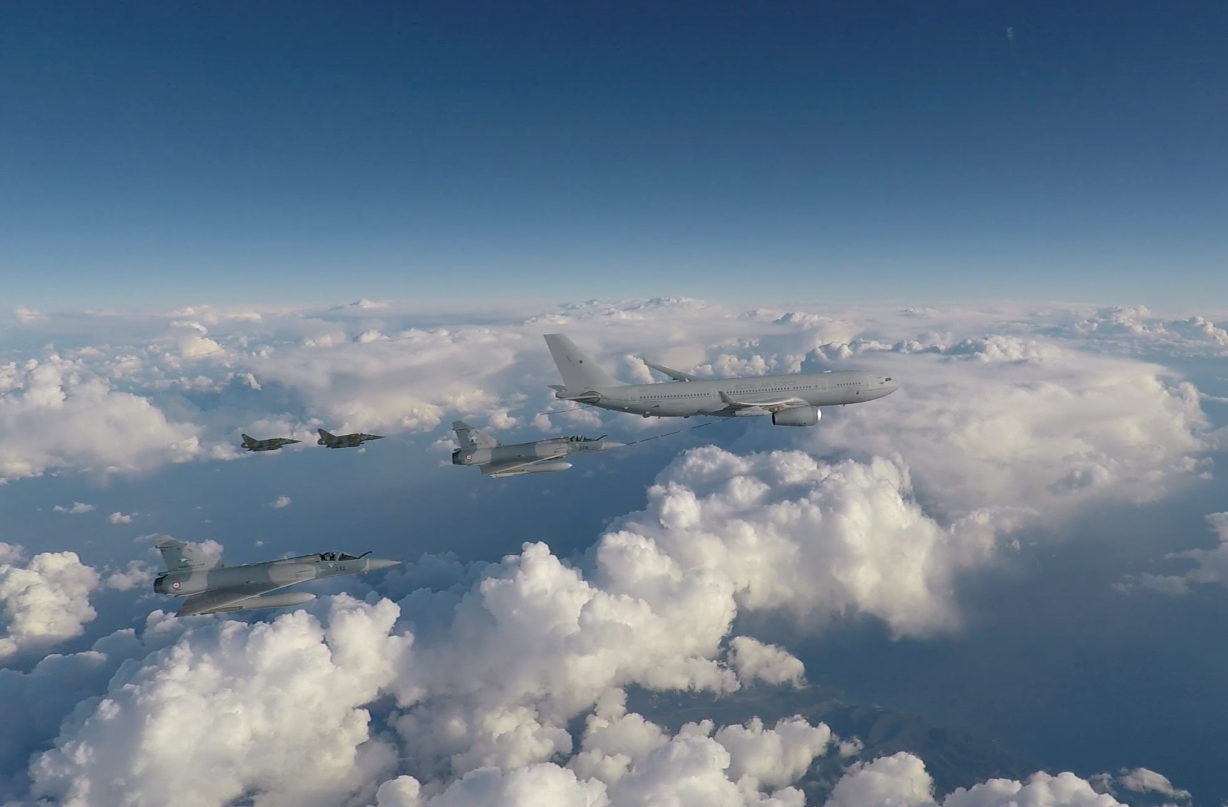 Image shows an RAF Voyager aircraft flying alongside four French Mirage 2000 aircraft.