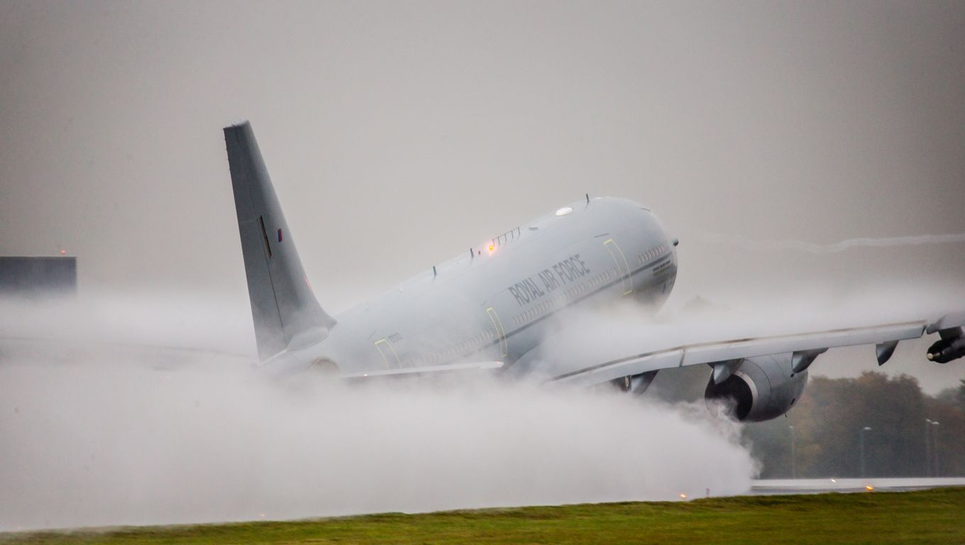 Image shows an RAF Voyager taking off in the rain.