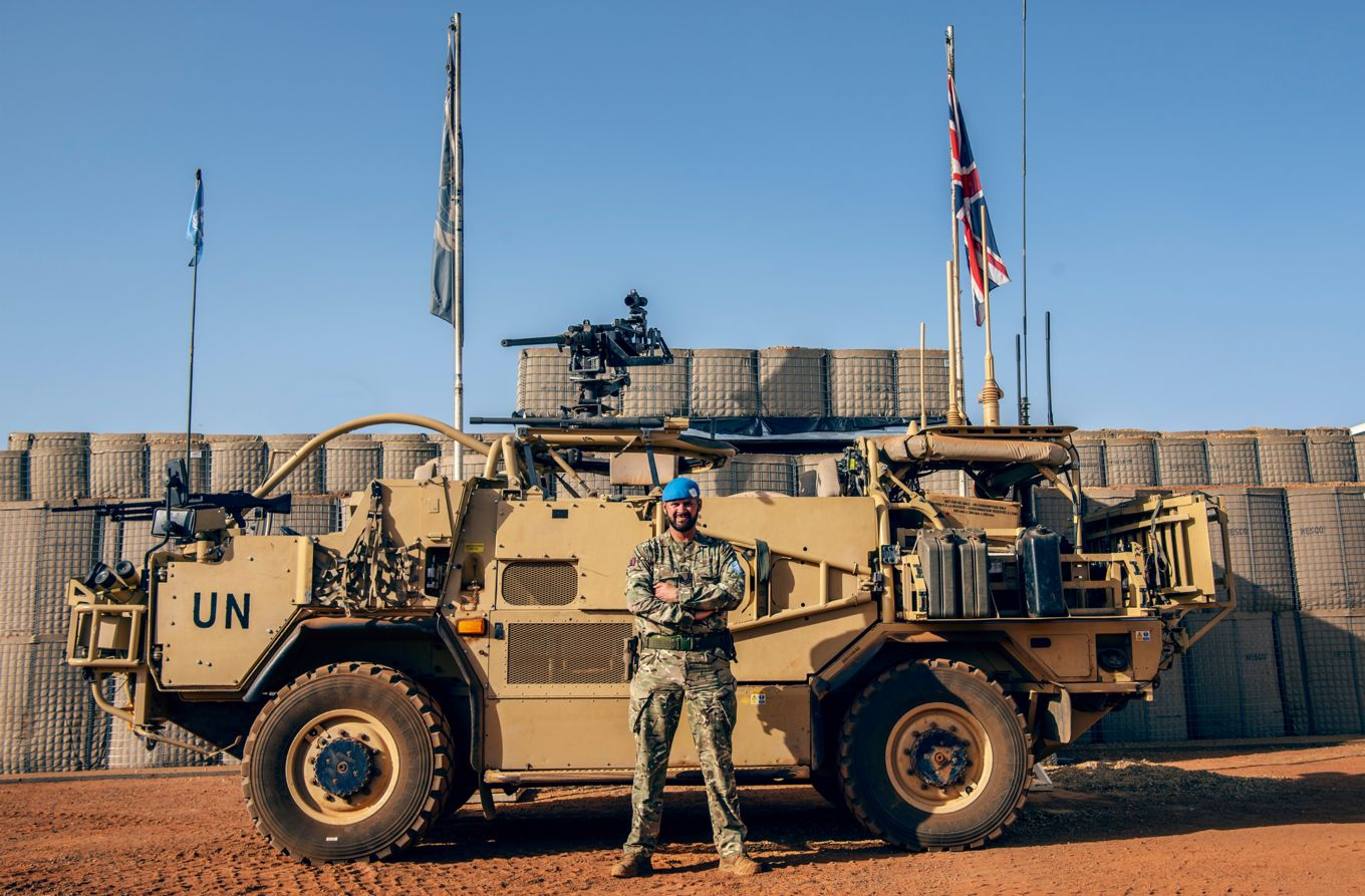 Image shows Sergeant Ashford in front of a military vehicle.