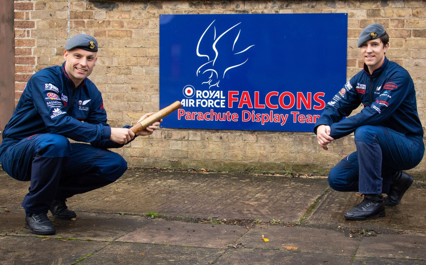 Flight Lieutenant Ash Grey-Smart hands over the RAF Falcons baton to Flight Lieutenant Chris Wilce