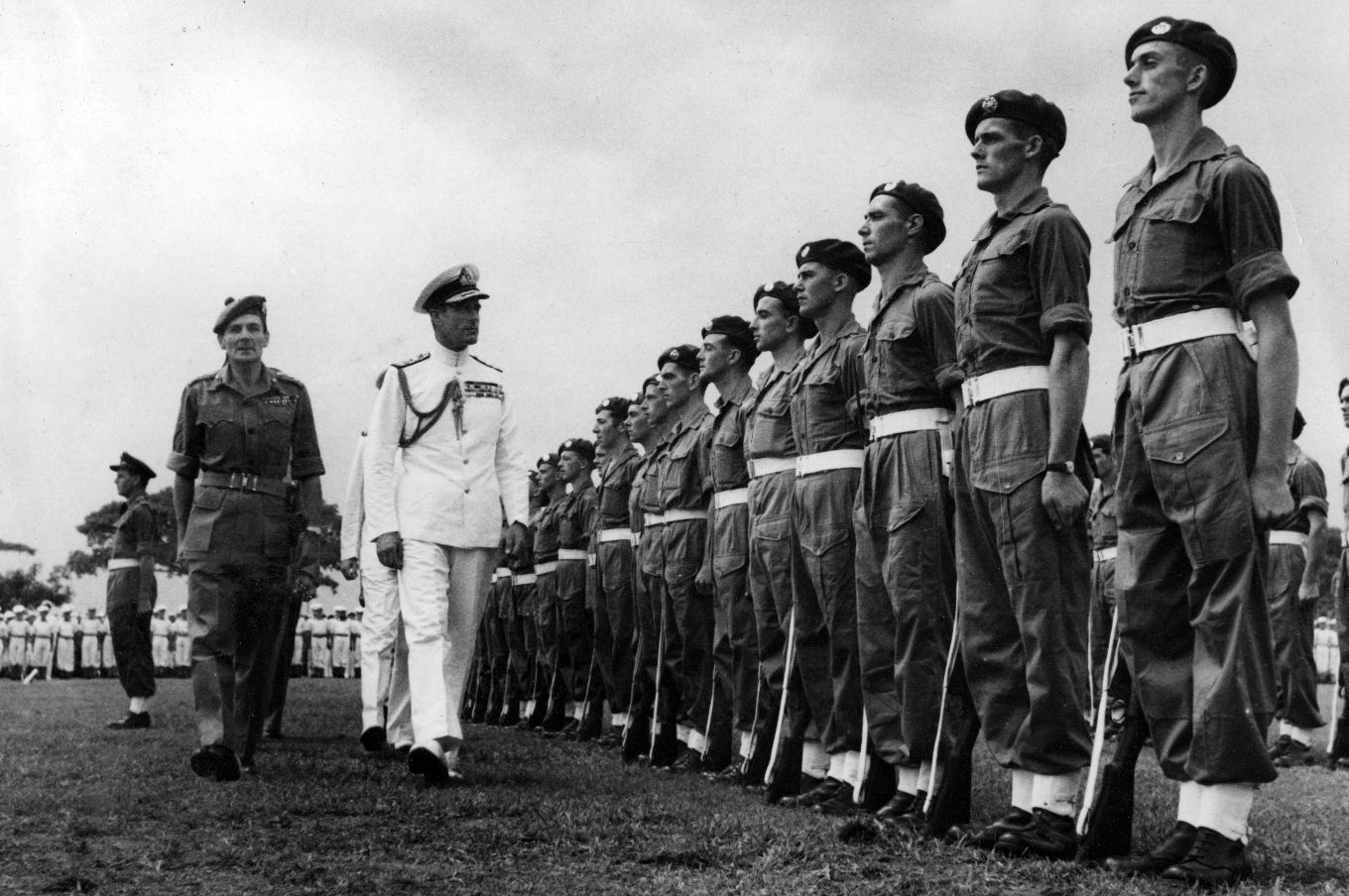 Admiral Lord Louis Mountbatten inspecting men of 2896 Squadron of the RAF Regiment outside the Municipal Buildings in Singapore prior to the signing of the Japanese surrender document