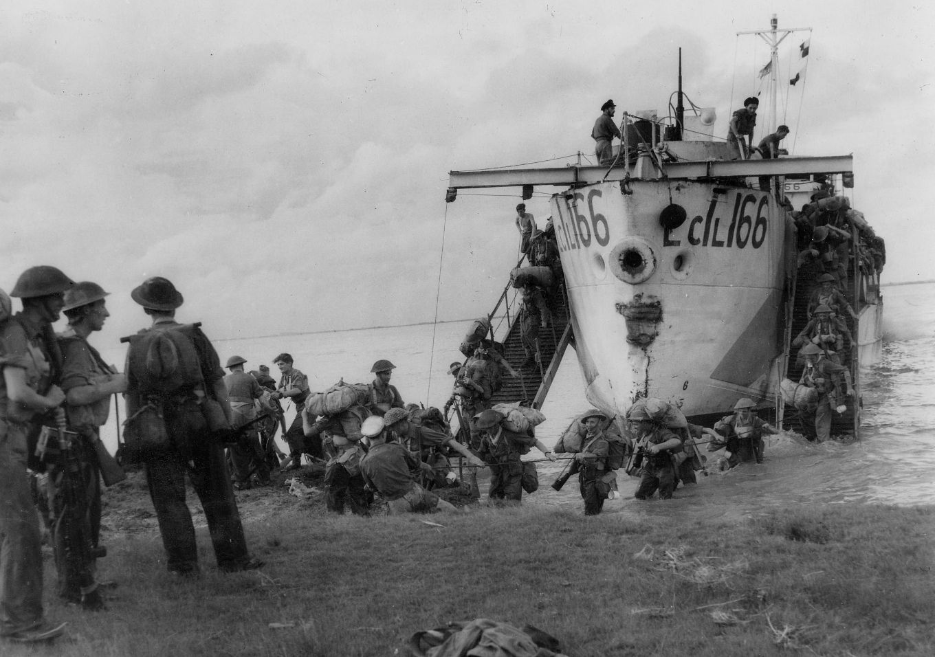 Operation DRACULA. Men of the RAF Regiment and groundcrews from a Supermarine Spitfire unit come ashore from a Landing Craft Infantry (Large) at one of the beacheads established near Rangoon, Burma