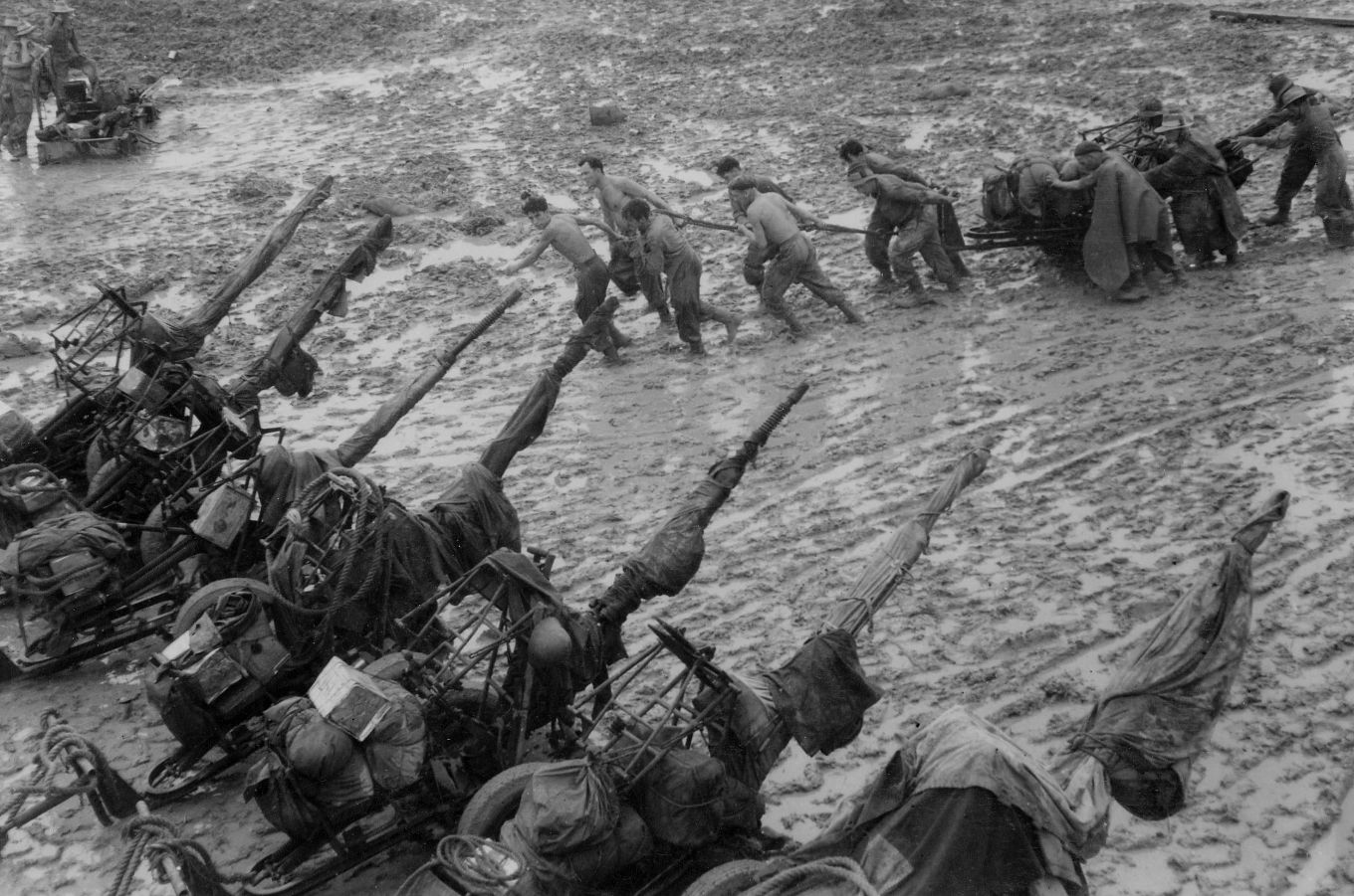 Operation Dracula. The Advance on Rangoon March - May 1945. Members of 2959 LAA Squadron, Royal Air Force Regiment, marshalling their 20mm Hispano anti-aircraft guns after coming ashore at Elephant Point on the mouth of the Rangoon River, in the monsoon rains