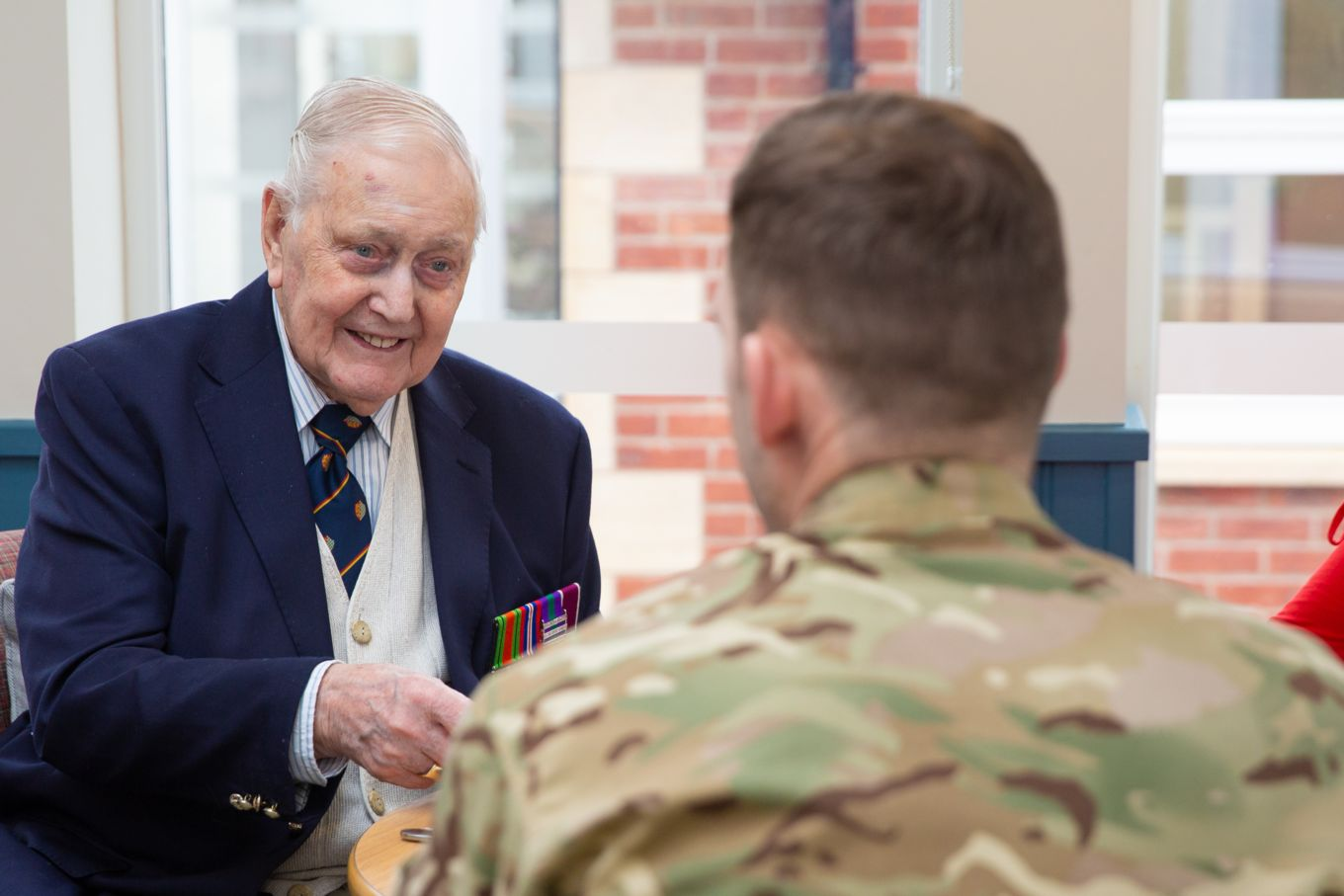 Mr James Fay in conversation with an airman from RAF Wittering